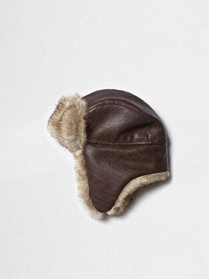Mössor - River Island Brown faux fur lined trapper hat