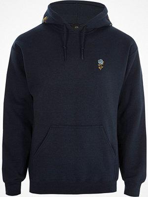 Street & luvtröjor - River Island Navy floral embroidered hoodie