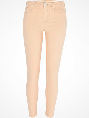 River Island Pink Molly skinny raw hem jeggings