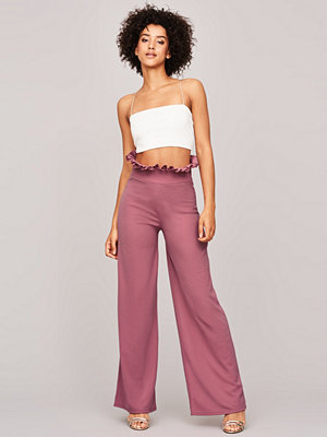 Gina Tricot omönstrade byxor So frill trousers