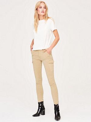 Gina Tricot gula byxor Alva cargo jeans