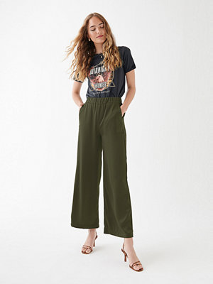 Gina Tricot omönstrade byxor Noomi satin trousers