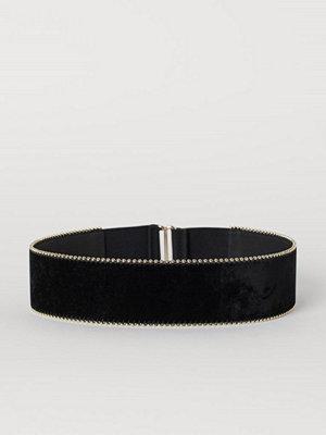 H&M Midjeskärp med nitar svart