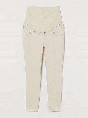 H&M MAMA Skinny Ankle Jeans vit