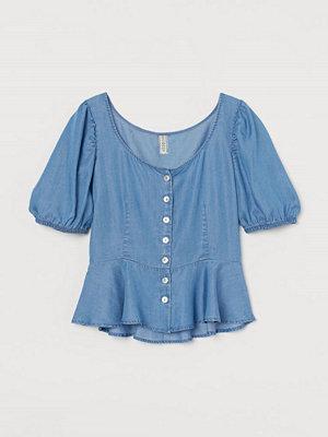 H&M Peplumblus i lyocell blå