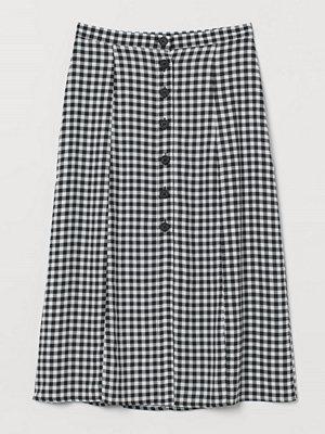 H&M Kjol med knäppning svart
