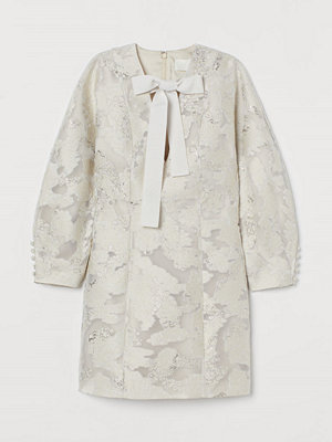H&M Jacquardmönstrad miniklänning beige
