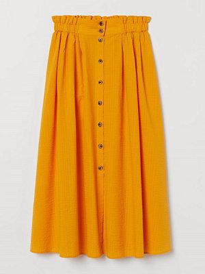 H&M Kjol i bäckebölja gul