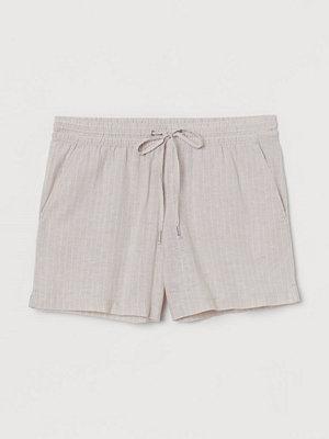 H&M Shorts i linmix beige