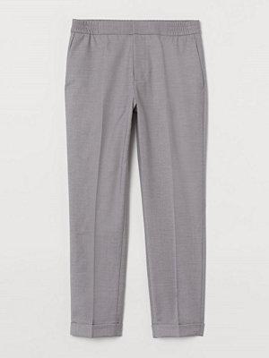 H&M COOLMAX® kostymbyxa Slim Fit grå