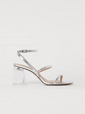H&M Metallicskimrande sandaletter silver