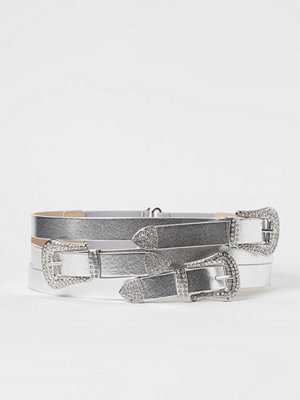 H&M Metallicskimrande midjeskärp silver