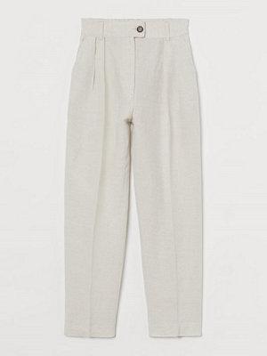 H&M ljusgrå byxor Ankellång byxa i linmix beige