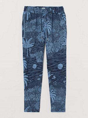 H&M marinblå byxor med tryck Pull on-byxa i linne blå
