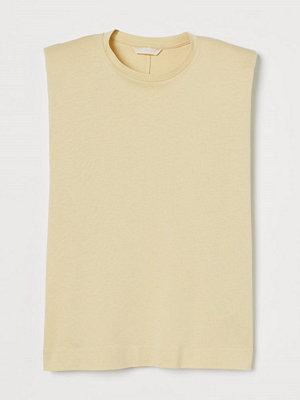 H&M Tanktop med axelvaddar gul