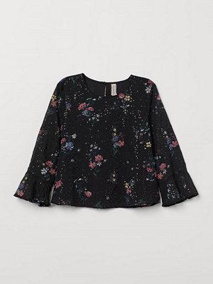 H&M Blus med volangärm svart