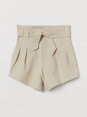 H&M Paper bag-shorts beige