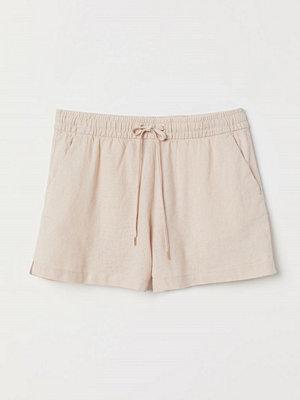 H&M Shorts i linmix orange