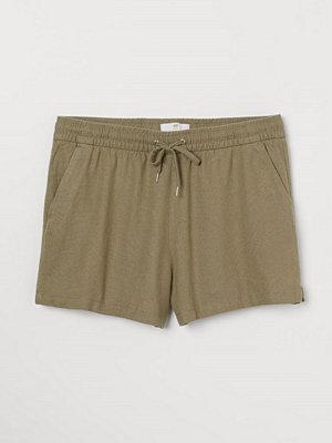 H&M Shorts i linmix grön