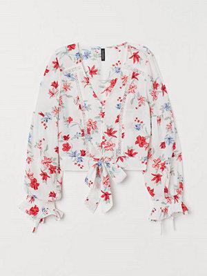 H&M V-ringad blus med knäppning vit