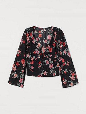 H&M V-ringad blus i chiffong svart