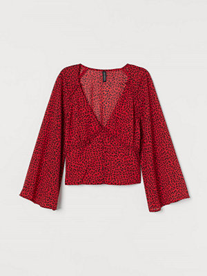H&M V-ringad blus i chiffong röd