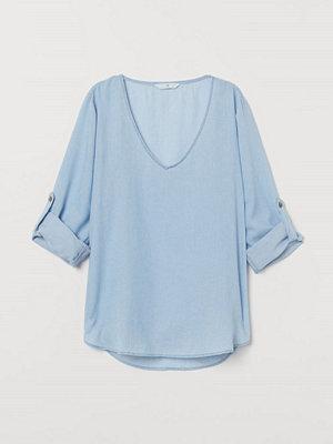 H&M Blus i lyocellmix blå