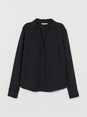 H&M V-ringad blus svart