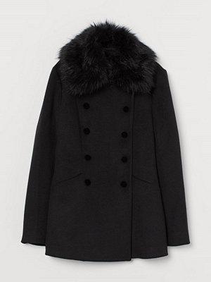 H&M Kort kappa med fuskpälskrage svart