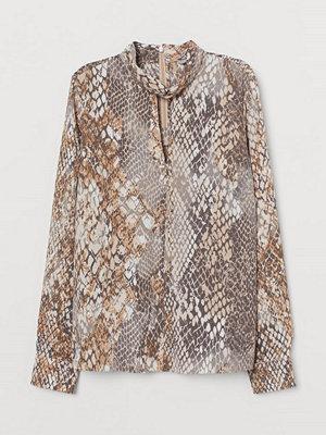 H&M Blus med ståkrage beige