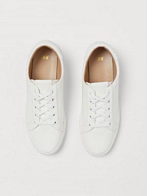 H&M Ormskinnsmönstrade sneakers vit