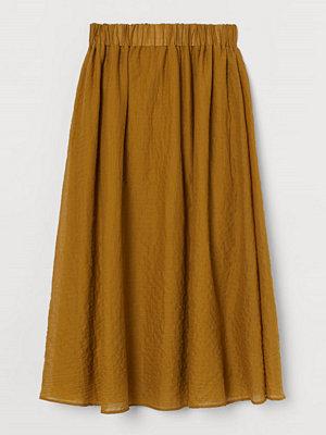 H&M Klockad kjol i pimabomull gul