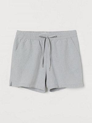 Shorts & kortbyxor - H&M Shorts i linmix turkos