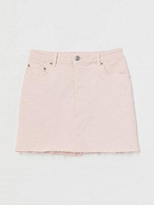 H&M Jeanskjol med rå kant rosa
