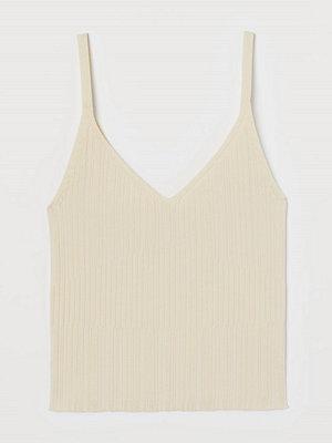 H&M Strukturstickat linne gul