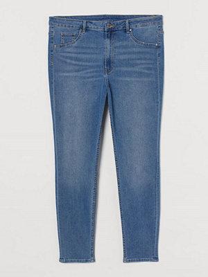 H&M H & M+ Curvy High Ankle Jeggings blå