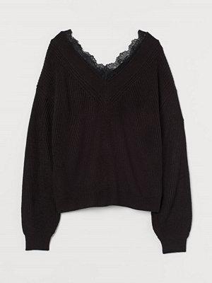 H&M Stickad tröja med spets svart