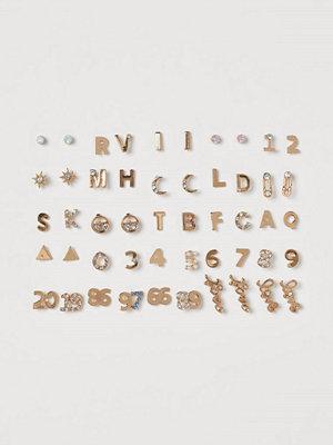 H&M örhängen 25 par studs guld