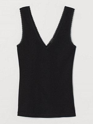H&M Ribbad tanktop med spets svart