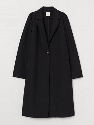 H&M Enkelknäppt kappa svart