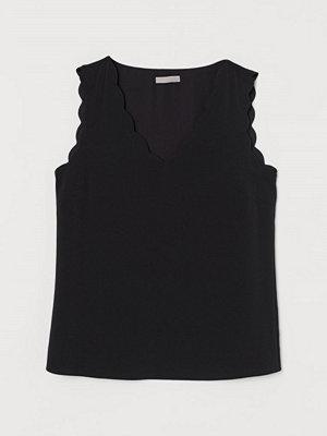 H&M Ärmlös blus svart