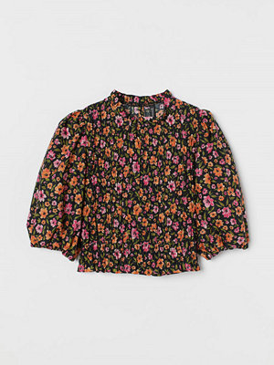 H&M Smockad blus med puffärm svart