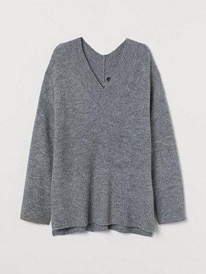 H&M V-ringad tröja i ullmix grå