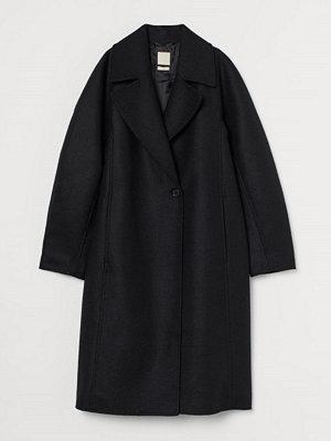 H&M Kappa i ull svart