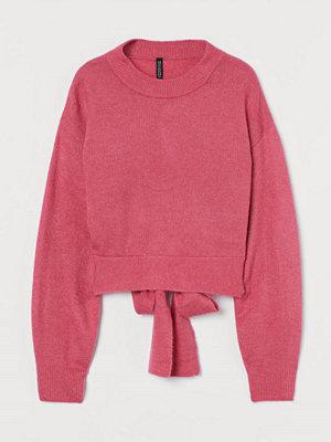 H&M Stickad tröja med knyt rosa
