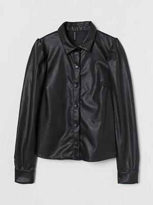 H&M Blus i läderimitation svart
