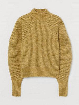 H&M Ribbstickad tröja i ullmix gul