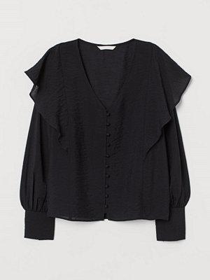 H&M Blus med volanger svart