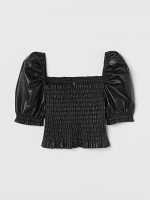 H&M Smockad blus i läderimitation svart