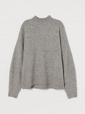 H&M Finstickad tröja med halvpolo grå